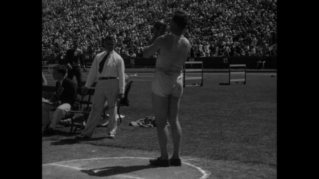 """""""leo sexton, n.y.a.c., who put shot 52ft. 8in. to break world's record..."""" / leo sexton makes shot put at stanford stadium, crowd in stands in bg,... - shot put stock videos & royalty-free footage"""