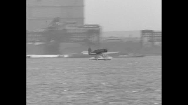 lindy and anne find plate fit for pacific hop famous flying couple tests craft at college point ny with load of 375 gallons of gas and new pontoons /... - charles lindbergh stock videos & royalty-free footage