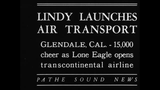 title card 'lindy launches air transport glendale, cal. - 15,000 cheer as lone eagle opens transcontinental airline' / at the ceremonies for... - passenger点の映像素材/bロール