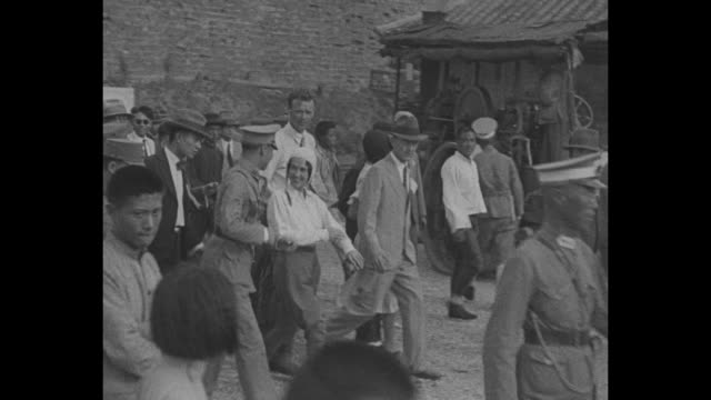 "vídeos de stock e filmes b-roll de ""lindys in china nanking – first pictures show anne and colonel in china shortly before news of sen morrow's death ended tour"" / charles and anne... - 1931"