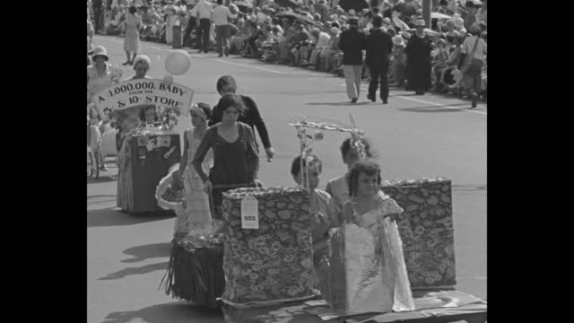 little americans have a big day in dazzling fete prides of many a household shine in picturesque asbury park pageant / vs children riding down street... - parade float stock videos and b-roll footage