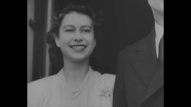 """long live the queen"" / june 27 left to right albert the duke of york , his wife elizabeth the duchess of york holding princess elizabeth, and queen... - elizabeth ii stock videos & royalty-free footage"