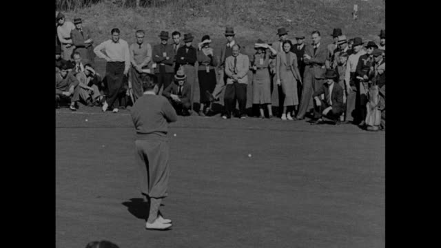 los angeles calif superimposed over man in midswing on golf course at griffith park in la / los angeles open golf tournament / spectators watch... - pga event stock videos and b-roll footage