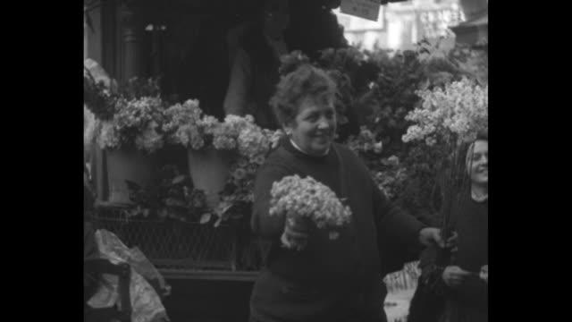 loud speakers help french sales drive marseilles fr flowery vendors vociferously hawk modest violets at city markets / elevation shot people wander... - card table stock videos and b-roll footage