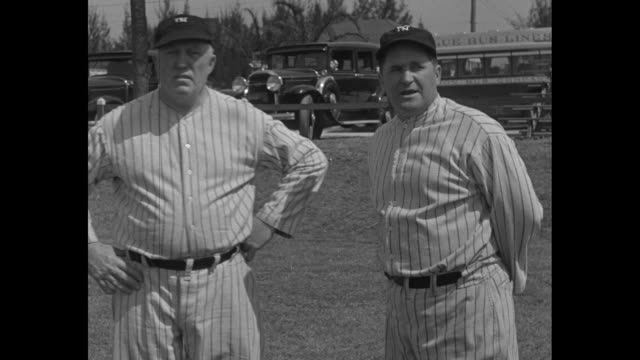 Manager McCarthy and Coach Burke discuss prospects/ 2shot New York Yankees manager Joe McCarthy at right and coach Jimmy Burke talk on field during...