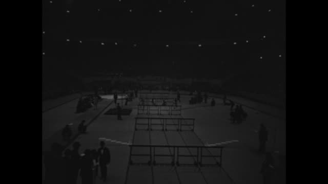 mangan beats cunningham in mile thriller / tilt down dash with hurdles / pole vault / shots repeat with no audio hurdle dash and audio during part of... - 1936 stock videos and b-roll footage