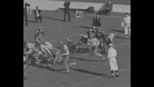 manual beats erasmus / crowd at stands at ebbets field for high school football game between manual training high school and erasmus high / kickoff... - ebbets field video stock e b–roll