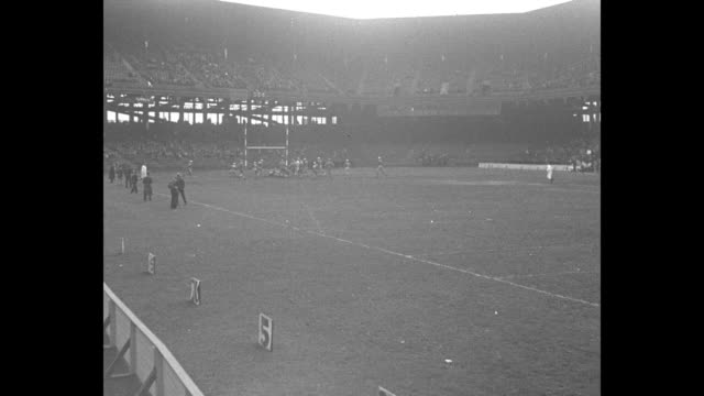 manual defeats erasmus / ls football game action at far end of field during game at ebbets field as manual training high school kicks off to erasmus... - ebbets field video stock e b–roll