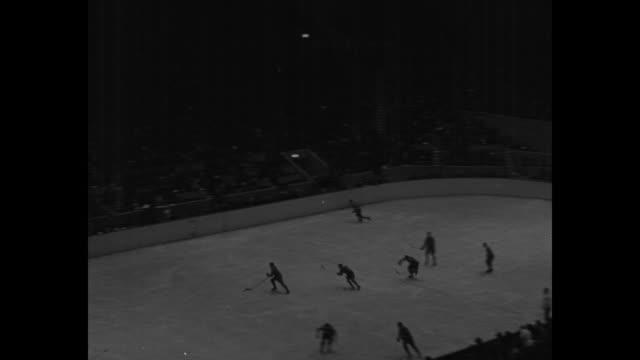 maple leafs and canadiens mix in fast hockey game speedy skaters flash around stadium in toronto in exciting clash before tense crowd / mcu toronto... - scrambling bildbanksvideor och videomaterial från bakom kulisserna