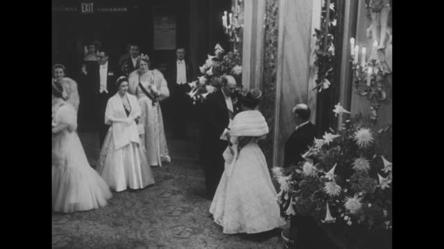 margaret says she will not wed townsend superimposed on crowd in lobby of royal opera house / queen elizabeth followed by margaret gets out of car /... - captain stock videos and b-roll footage