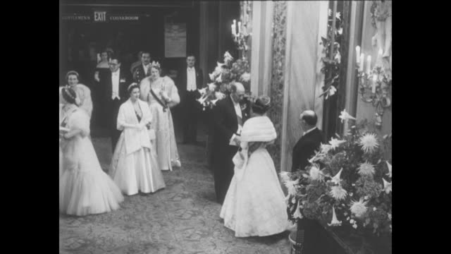 stockvideo's en b-roll-footage met margaret says she will not wed townsend superimposed over ws people in evening dress at the royal opera house / elizabeth the queen mother and... - prinses margaret windsor gravin van snowdon