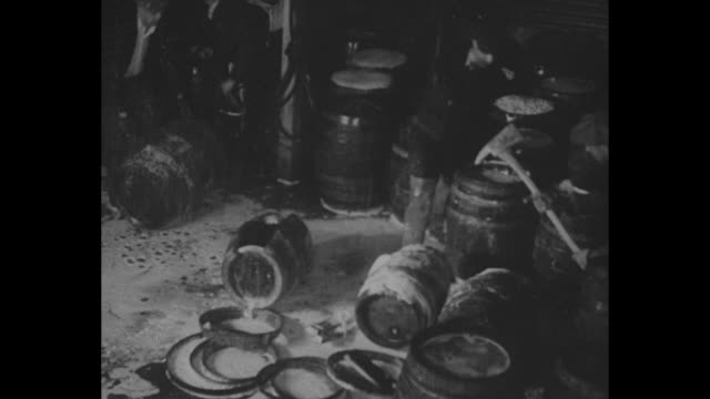 """vidéos et rushes de """"mash note: us confiscates big 'capone brewery' - government agents turned raided $75,000 plant into foaming torrent as they destroy barrels of beer... - prohibition"""