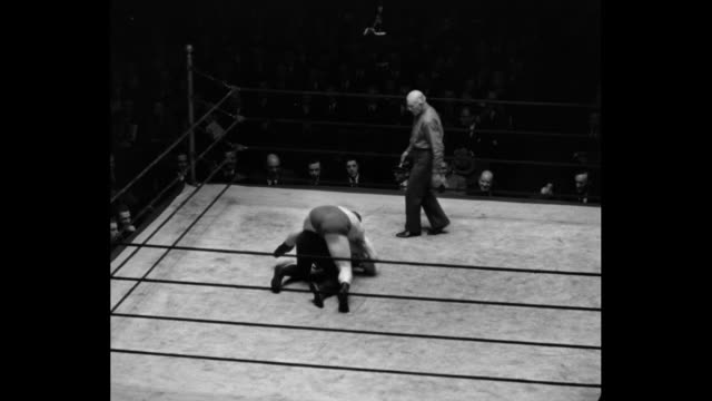 'Mat Contortionist Wriggles To Win As Customers Hold Sides Fritz Kley in short trunks shows weird form in New York bout with Pierotti' / various...