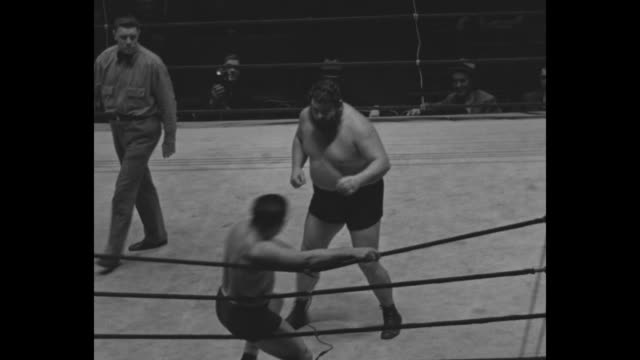 """Mat Styles For 1934 New York – The maulers go into action Wrestling fans how as Dusek the Dangerous gives 'ManMountain' Dean 'de woiks'' / several..."