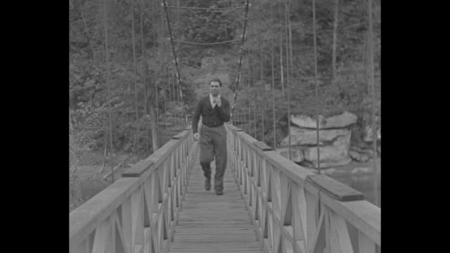 Max Schmeling and Joe Louis in training / boxer Max Schmeling walks across suspension bridge / Scheming canoeing / in hip boots fly fishing / jogging...