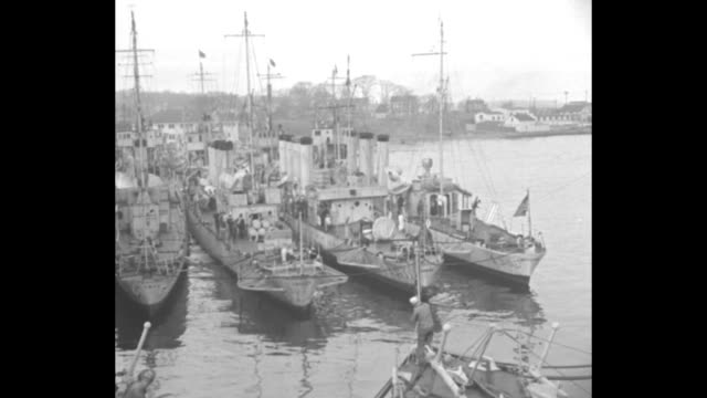 meanwhile war the dry navy made up of 500 ships of coast guard patrols the sea seeking and shooting rum runners / docked ships and boats building in... - plunger stock videos and b-roll footage
