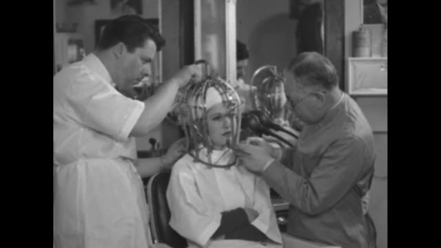 measures beauty new machine mask registers good looks of hollywood movie stars / two men adjust measuring machine fitted over woman's head mirror in... - measuring stock videos & royalty-free footage