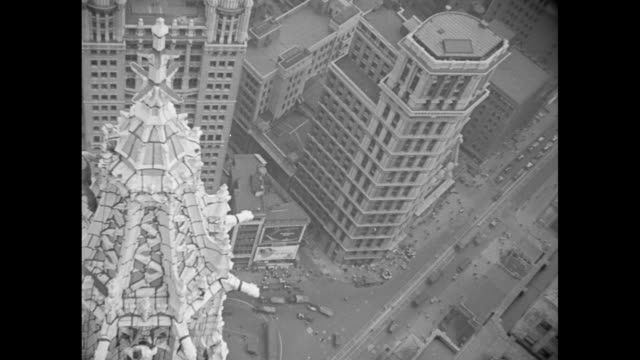 "men at the top of their profession are caught unaware trying to clean up the woolworth building"" / mls high angle looking down on spire of new york's... - climbing frame stock videos & royalty-free footage"