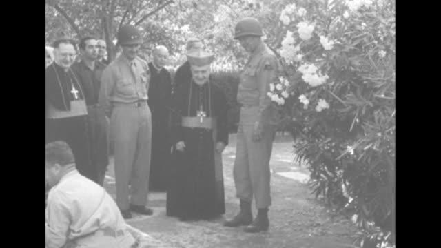 Meeting Cardinal of Palermo greets Gen Patton / LR Maj Gen Geoffrey Keyes Cardinal Luigi Lavitrano Gen George S Patton / CU Lavitrano / VS the men...