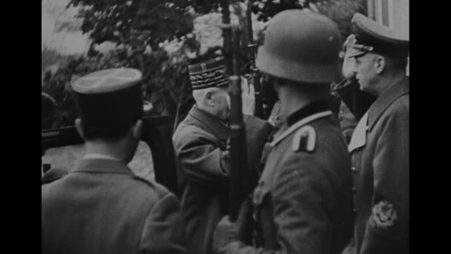 """meeting with petain, laval and franco in france october 1941"" / world war ii / french language / german soldiers at attention line the street /... - adolf hitler stock videos & royalty-free footage"