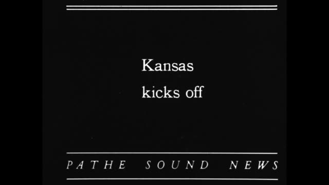 'Missouri Beats Jayhawks 7 0 Lawrence Kansas Tigers Triumph Over Kansas in Annual Tilt Before 27000' / Tilt down band on football field / Title card...