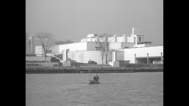 modern sinbad joe bellocq paddles odd raft to chicago as world fair wonder / two shots of bellocq paddling raft on lake michigan towards chicago /... - chicago world's fair stock videos & royalty-free footage