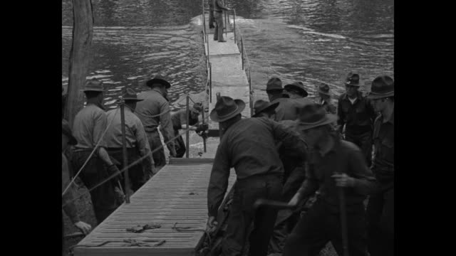 modern soldiers cross historic delaware on foot us engineers run across river on latest pontoon span at spot where washington's men used boats / in... - pontoon bridge stock videos and b-roll footage