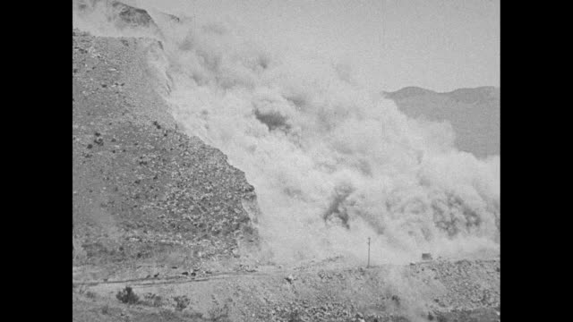 'Monolith Calif Terrific Explosion Crumbles Mountain Side000 Pounds of Dynamite Used to Move Rock in Production of Cement' / MS explosion and large...