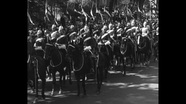 """""""montreal garrison thrills canadians in church parade - colonel sutherland inspects defenders of dominion as they pass in review"""" / mounted soldiers... - military parade stock videos & royalty-free footage"""