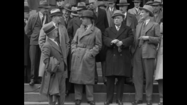 'Montreal Hails Champion English Cricket Team' / pan members of English cricket team the Marylebone Cricket Club wearing hats and overcoats and...