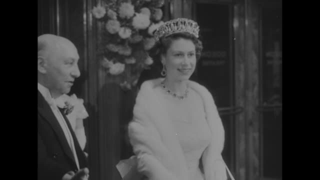 Movie News / title Queen Meets Movie Queens and Kings superimposed over man bowing to Queen / Queen Elizabeth II in formalwear walks into a room to...