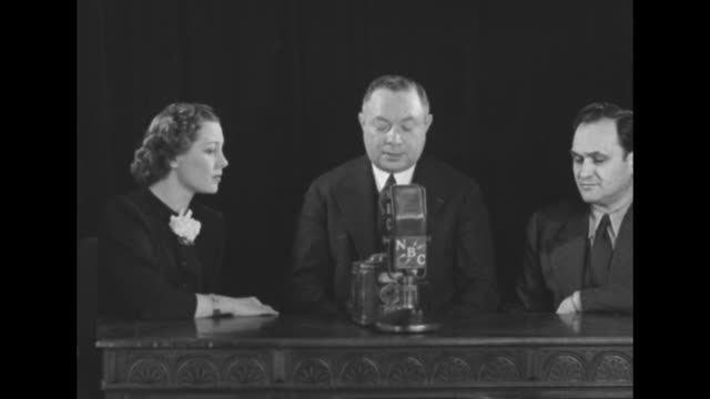 """""""music week"""" / at table with nbc microphone are from l to r gladys swarthout, opera singer; david sarnoff, president of rca; mario chamlee, chairman... - rca stock videos & royalty-free footage"""