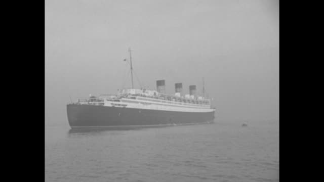 """""""names and events in the headlines"""" / title """"new york harbor"""" superimposed over shot from boat of british ocean liner """"queen mary"""" carrying joseph p.... - looking at camera stock videos & royalty-free footage"""