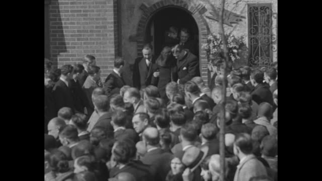 """""""nation mourns knute rockne - famous coach starts last journey from his home in south bend followed by his wife, children and mother"""" / pallbearers... - holy water stock videos & royalty-free footage"""