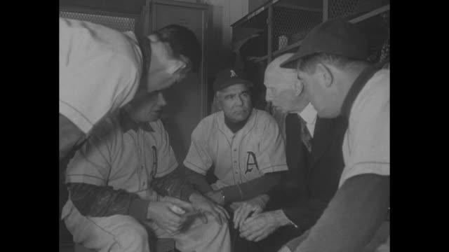 Nation Mourns 'Mr Baseball' / Philadelphia Athletics manager owner president Connie Mack in baseball team dressing room / Mack talks to Athletics...