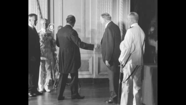 'Nations End Wars President Hoover Proclaims Kellogg Pact in Effect Washington Envoys and dignitaries gather in East Room at White House for...