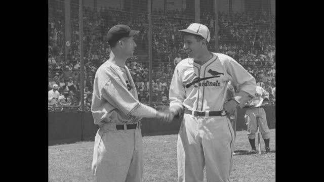 nat'l league wins allstar game 4 to 3 / establishing shot of braves field / national league team standing in dugout together / robert lefty grove and... - star jump stock videos & royalty-free footage