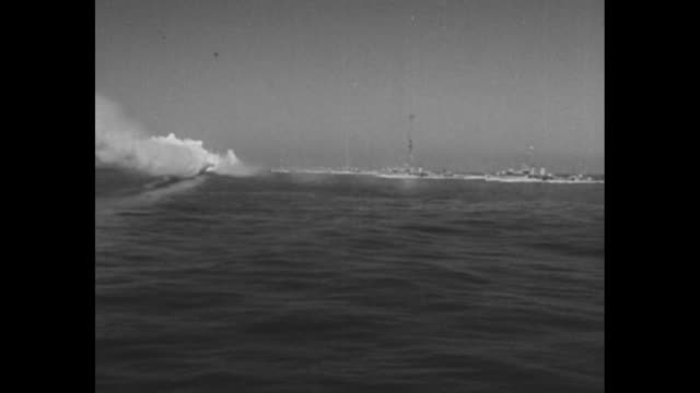 """stockvideo's en b-roll-footage met """"navy day 1936"""" superimposed over warships and helicopters / navy enlistment poster / line of us warships and planes / warship / vs plane taking off... - in dienst gaan"""