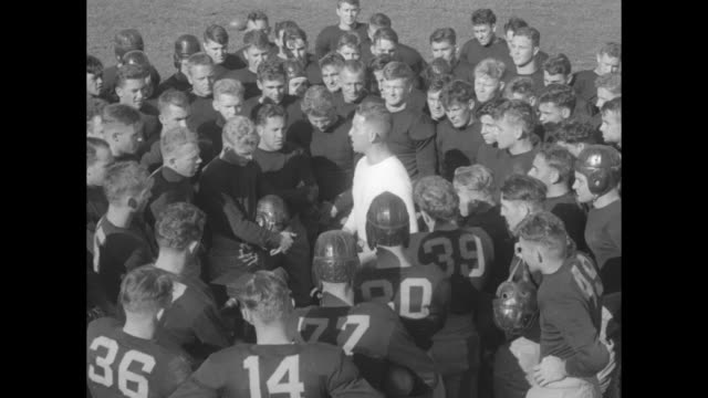 vídeos de stock e filmes b-roll de navy football team anxious to sink 'em all coach miller peps up annapolis squad for big season to end with army game / in a white sweatshirt and... - sweatshirt