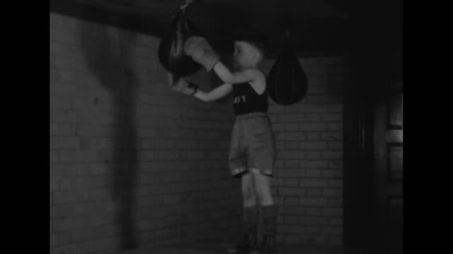 """""""navy juniors full of fight! sons of officers at annapolis prefer punches to pacifism"""" / vs numerous little boys in an humorous melee in a boxing... - box container video stock e b–roll"""