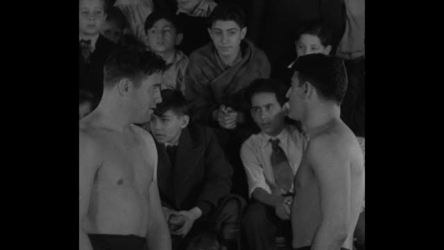 """never too young… new york — 'wanna hassle skinny' sammy stein 200pound contender for world's wrestling title shows orphan boys how"" / stein right... - arm wrestling stock videos & royalty-free footage"