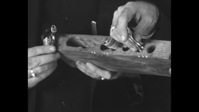 new evidence strengthens case against hauptmann / ms investigators outside bruno hauptmann's garage debris on ground / cu hands hold piece of wood... - nursery bedroom stock videos & royalty-free footage