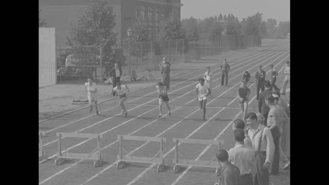 """""""new jersey"""" superimposed over female athletes at start line / vs runners from start to finish line of 100 meter dash at the women's a.a.u.... - shot put stock videos & royalty-free footage"""