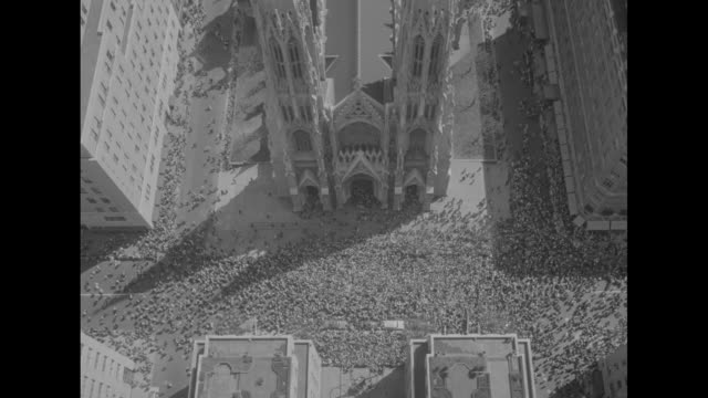 new york superimposed over ls dense crowd on fifth avenue in new york city / aerial saint patrick's cathedral showing cruciform layout of building... - columnist stock videos & royalty-free footage