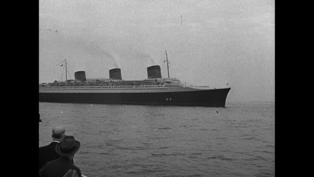 news flashes from everywhere / title new york harbor superimposed over ss normandie sailing in harbor / lady nancy astor stands at bank of... - normandie stock-videos und b-roll-filmmaterial