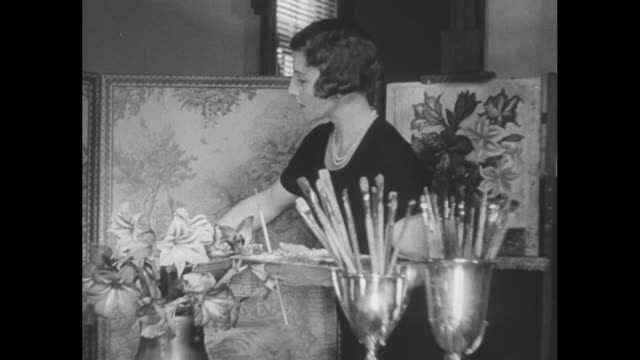 news flashes / tennis player helen wills moody wearing a black dress and pearls takes her place at an unfinished painting she arranges flowers in a... - artist stock videos & royalty-free footage