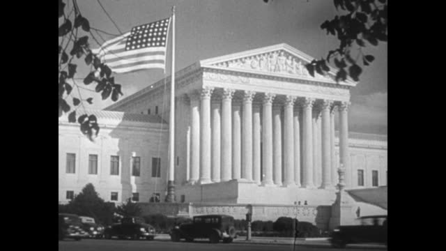 """news flashes!"" / two shots of exterior us supreme court building, us flag flying in front of building / two men opening large doors at entrance of... - us supreme court building stock videos & royalty-free footage"