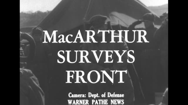 'news from abroad' / title card 'macarthur surveys front' superimposed over macarthur in heavy coat coming out of tent as soldiers salute / cu... - general macarthur stock videos & royalty-free footage