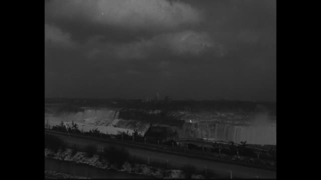 niagara falls hails 'the neighbour next door / pan down from theater marquee touting the neighbour next door to niagara falls ny mayor william lupton... - jack hawkins stock videos and b-roll footage