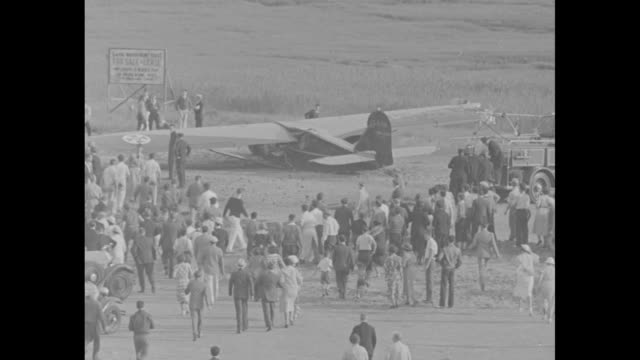 """""""ocean flight crash"""" / albert and george monteverde, brothers from portugal, stand in front of bellanca j-2 special airplane / brothers wave from... - directing stock videos & royalty-free footage"""